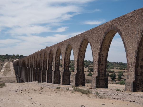 Started by Padre Tembleque in 1553, finished 17 years later the aqueduct was the tallest in the world since Roman times. This arcade (segment) has 67 arches, is 127 feet high at the ravine, nearly half a mile long