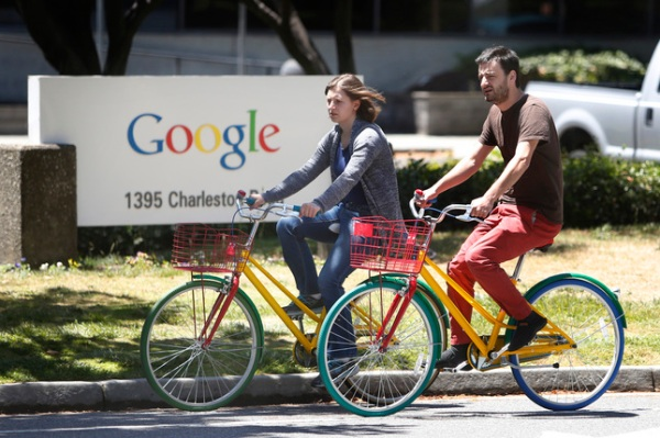 Google employees ride their Google multi-colored bicycles to and from the GooglePlex along Charleston Road in Mountain View, Tuesday, June 24, 2014. Large and small, buildings are being collected in Mountain View by Google, which is on a shopping spree for parcels near -- and sometimes not so near -- its headquarters in Mountain View. (Patrick Tehan/Bay Area News Group)